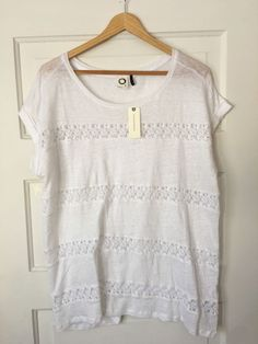 """New with tags Akemi   Kin Lattice Stripe Tee in white. Linen. Size large. Approximate measurements: Shoulder to shoulder: 16"""" Underarm to underarm: 23.5"""" Length: 28"""" Sleeve: 4"""" Returns accepted within 30 days; buyer pays return shipping and 15% restocking fee. Thanks for stopping by! 