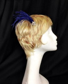 Electric violet ostrich feather and silver Victorian hair comb on Etsy, $18.00
