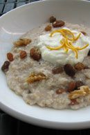 Boil Oatmeal. Add nut. Mix natural yogurt with natural orange juice, add on top.