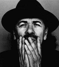 Carlos Santana the wizard,master of music and     Wise person creating magic sounds!