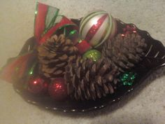 fun centerpiece filled with pinecones decorative balls and ribbon.