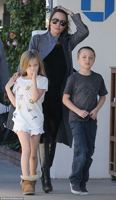 Retail outing: Angelina Jolie took Vivienne and Knox,her eight-year-old twins with Brad Pitt, on a shopping trip to Malibu Country Mart on Saturday