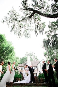 First kiss as husband and wife at an outdoor estate wedding in College Park, Florida | Debra Eby Photography Co.
