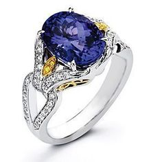 The breathtaking designs of Simon G. are on display in another striking ring.  The Simon G. ring is set in 18 karat white and yellow gold with .47 carat total weight white diamonds and .03 carat total weight yellow diamonds set to enhance an oval cut 5.54 tanzanite center.  For the allure of designer jewelry, be sure to look for Simon G., available at Kranichs Jewelers.