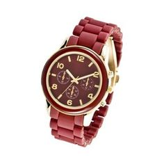 Simple and inexpensive but unique watch for everyday wearing: rubber band with similar maroon colored face with gold accents. Large face; mimics a man's watch but is female in nature.