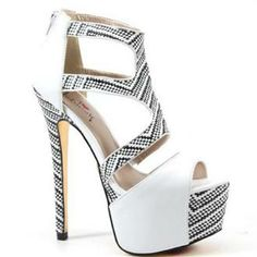 Luichiny A Byss in White The Tribal look is one of the hottest styles for Spring 2014.  Luichiny has developed the A Byss which is sweeping the nation.  Material:  imi leather  Heel Height:  6 inches   Color Contrasting and Much More  Retail Price: $84.95 www.Nchantment.com