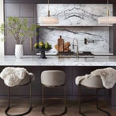 Many of you have asked about these stools at the #fedoraresidence. We got them through @wayfair about three years ago and had the chrome base re-plated in an antique brass finish to match the other fixtures in the kitchen. #interiordesign by @namdangmitchell #kitchen #design #interior #cabinetry by @sunviewcustomcabinetry #statuario #marble by @alberta_marble_and_tile_co_ltd #vintage #lights from @lynngoodevintage #faucet by @aquabrass #customhome by @rawlykdevelopments #architecture by…