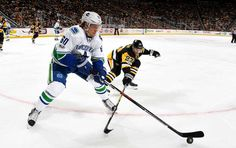 Penguins vs. Canucks - 02/14/2017 - Pittsburgh Penguins - Photos Markus Granlund #60 of the Vancouver Canucks handles the puck in front of Scott Wilson #23