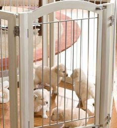 Create a safe enclosure to restrict your pet's access to certain parts of your home without sacrificing your home's style with the Six-panel Antique White Hardwood Pet Gate and Crate.