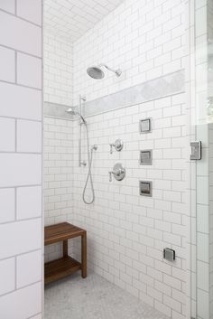 Wall tile: Soho White Matte Subway with Carerra marble accent band; Floor tile: Carerra marble hexagon
