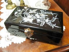 Lacquer inlaid pearl jewelry box from Vendor 889 in booth 187. Priced at $29.00. The Brass Armadillo Antique Mall has great gifts for everyone on your list. Come in and shop with us today. WheatRidge, CO. (303) 403-1677.
