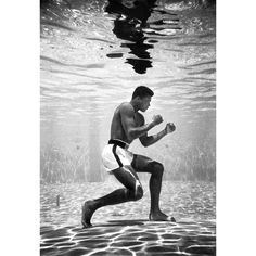 Float like a butterfly - sting like a bee. Muhammad Ali was the greatest boxer in history. Before he was Muhammad, he was Cassius Clay. This photo shows him training and posing underwater at the Sir John Hotel, Miami in 1961 Mohamed Ali, Muhammad Ali Boxing, Muhammad Ali Quotes, Photo Star, Air Photo, Foto Poster, Poster Poster, Float Like A Butterfly, Monochrom