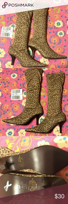 """NEW VICTORIA'S SECRET POPSICLE ANIMAL PRINT BOOT 7 NEW.  Victoria's Secret """"POPSICLE"""" stretch animal print boot.  Super rare and very cute.  These boots are pull on and have stretch shaft. Pointy toe and 3"""" heel.  I have enclosed a picture of the inside in a """"cuffed"""" picture. Size 7M, fabric upper and leather sole.  Balance is man made.  Animal prints will be trending later this year big time.  Be ahead of the trends!  So cool with jeans, mini skirts, dresses! The shaft is 12"""" tall.  I love…"""