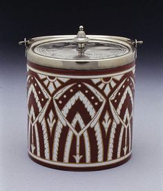 Biscuit box with cover, Designer: Christopher Dresser (British, Glasgow, Scotland 1834–1904 Mulhouse) Manufacturer: Possibly James Macintyre and Co. Date: ca. 1870 Culture: British Medium: Earthenware, silver plate Dimensions: H. with cover 5 3/4 in. (14.6 cm.); Diam. 4 7/8 in. (12.4 cm.)