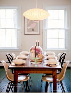 farm dinning table with plastic chairs...love!