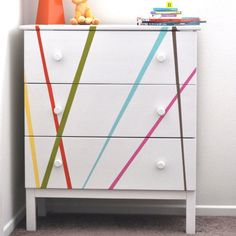 A fun, whimsical and colorful Ikea Tarva dresser makeover. Perfect for a gender neutral kids room or baby's nursery! And it was oh so easy!