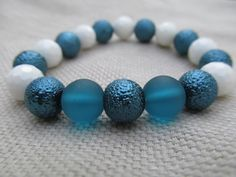 White faceted shell blue bumpy glass pearl by littlecrowshop, $17.00