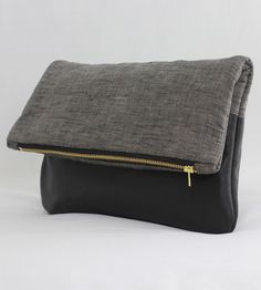 http://scoutmob.com/p/Black-Leather-and-Linen-Foldover-Clutch?ref=cat_womens_bags-and-wallets