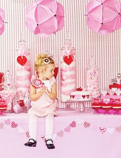Super cute girls party idea... check out those paperplate hanging balls! Awesome!  (Link doesn't go anywhere, but it looks pretty easy to figure out those paper plate balls!)