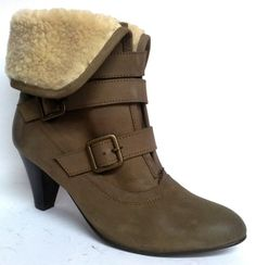 Beat the cold with this suede and fur lining boot.