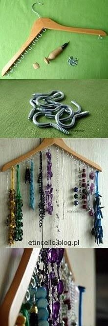 Necklaces Organizer. Unused wooden hanger, some hooks and you're good to go for your charms. Neat and organized. #organization #ideas #necklaceorganizer