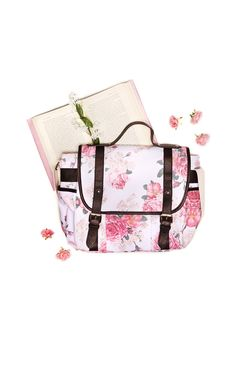 """Fresh-picked flowers and a Jane Austen book. Fill up this messenger bag with all of your favorite things. The perfect book bag to wear cross-body. Or, carry it by the simple handle. Interior and exterior pockets. Adjustable strap. Real pebble leather contrasted by a soft, rose-print, cotton canvas. White, vinyl lining.  100% Cotton Canvas / 100% Vinyl Lining   11.25 x 11.5 x 7   13"""" Strap"""