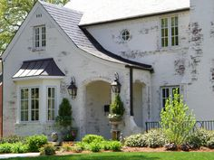 gray brick house | white wash, or lime paint