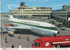 The Apron at Dublin Airport by Elmar Ludwig. A John Hinde postcard of the late with showing the Old Terminal building and Pier A - now the 100 gates on the right. Boeing 720, Boeing Aircraft, Famous Photos, Old Photos, Jets, Illinois, Dublin Airport, Dublin Street, Old Lorries