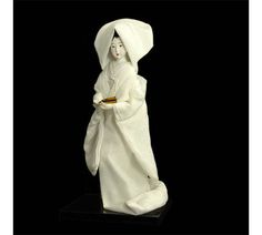 Our stunning Oyama Doll is the perfect addition to any doll collection or as a very special gift. This Japanese Bride Doll is wearing a traditional wedding kimono and a shiromuku with a white hat, watabohshi (綿帽子). Made in Japan