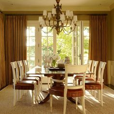 Fabulous creme and leather chairs in this dining room by Christine Markatos Design.