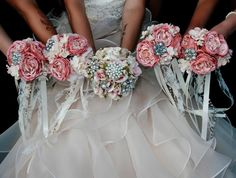Classy, vintage and unique bouquets. Lace ribbon hanging from the silk flowers. It is WAY cheaper than real flowers, and your bridesmaids get to keep them! I added a brooch to them because my bouquet was a brooch bouquet!