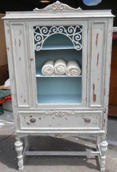 Vintage depression china cabinet hand painted with ASCP in French Linen, distressed and used clear wax. Inside of cabinet is painted with Duck Egg Blue. LP