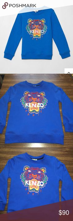 🆕 Kenzo Tiger Sweatshirt Excellent Condition Kenzo Round Collar long sleeve sweatshirt with Tiger embroidery on the front. Embroidery is linned to avoid irritation. It's made of cotton and has ribbed cuffs. Purchased at Kenzo for $110 and worn once. Tags available and price Firm Kenzo Shirts & Tops Sweatshirts & Hoodies