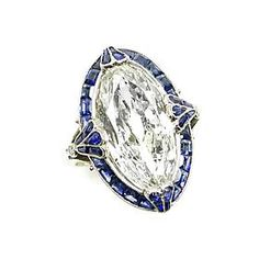 Early 20th century single stone marquise diamond and sapphire cluster ring, c.1910
