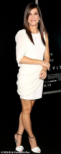 Stunning: The beautiful brunette actresses looked stunning in their white dresses at the Gravity premiere