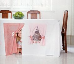 Under the table hide away. I will be trying this with my daughter when she's a little older. :o)