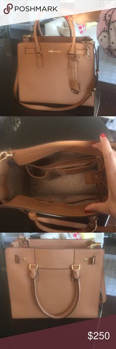 Michael Kors Handbag Michael Kors camel color structured handbag. Brand new without tags. Was a gift from husband but have to sell cos have a similar handbag. Michael Kors Bags Satchels