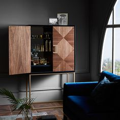 Raise the bar this holiday season with an ultra-glamorous cocktail cabinet or home bar that's bound to cause a stir with guests.