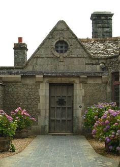 Courtyard door at Porth en Alls The Cornish coast path runs through the central courtyard of Porth en Alls, the big house, UK