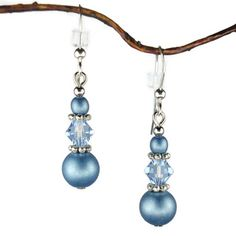 Beautiful earrings made with blue glass beads along with sparking blue crystal bicone beads separated by pewter spacers. The earrings are hung on .925 sterling silver french hook earwires. Total lengt