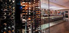 Floor to ceiling glass wine cellar