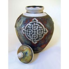 Gorgeous Celtic cremation urn fired in the Raku pottery style. Raku Pottery, Glazes For Pottery, Burial Urns, Funeral Urns, Jar Design, Hand Thrown Pottery, Cremation Urns, Celtic Knot, Ceramics Ideas