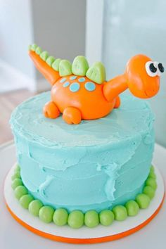 dinosaur cake. easy with cute frosting color and one of his favorite dinos on top