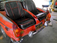MGB. Used trunk lid to make divider with beer holder.