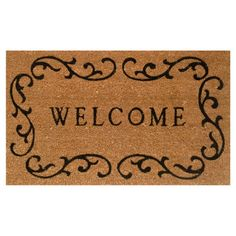 Welcome family and friends to your home with this lovely doormat, featuring a traditional scrolling border. Product: Doormat...