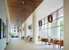 The main corridor in the clinical suite is the only space with a wood ceiling a distinctive for Milwaukee interior design firms