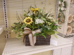 new basket/box,with flowers and greens sherrie Michales NJ