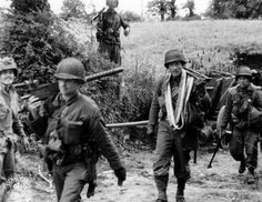Men of the 4th Infantry Division (and a paratrooper of the 101st) in Normandy, June/July 1944