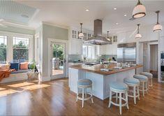 coastal kitchen with window seat and beautiful lighting #hamptonsstyle #windowseats #lighting