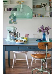 Sweet! Love the color of the Kitchen Aide. And of course, the table!